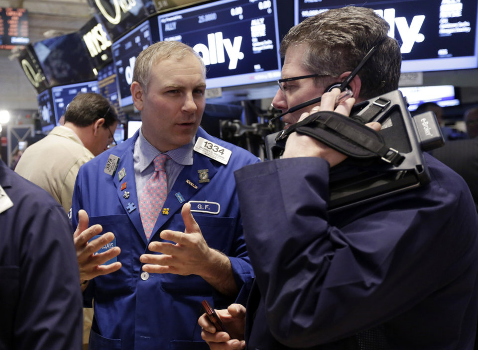 Photo - Specialist Geoffrey Friedman, left, and trader Sean Spain work on the floor of the New York Stock Exchange Thursday, April 10, 2014.  U.S. stock indexes are slipping lower in early trading Thursday as investors pick over a mixed batch of corporate earnings reports. (AP Photo/Richard Drew)