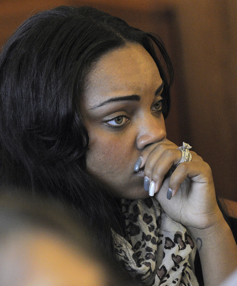 Photo - Shayanna Jenkins, fiancee of former New England Patriots football player Aaron Hernandez, listens in the courtroom during a bail hearing for Hernandez in Fall River Superior Court Thursday, June 27, 2013, in Fall River, Mass. Hernandez, charged with murdering Odin Lloyd, a 27-year-old semi-pro football player, was denied bail. (AP Photo/Boston Herald, Ted Fitzgerald, Pool)