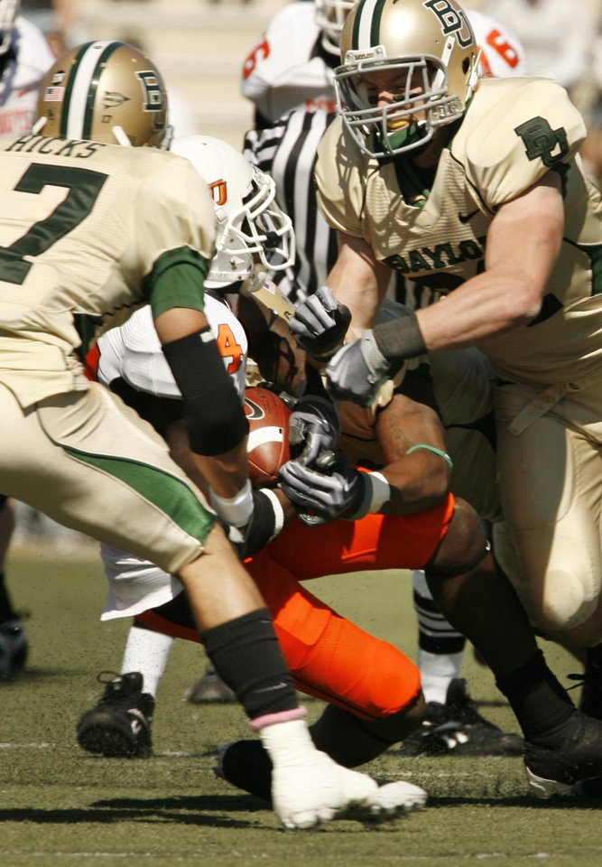 Photo - Hubert Anyiam (84) is brought down after a catch and run during the college football game between Baylor University and Oklahoma State University (OSU) at Floyd Casey Stadium in Waco, Texas, on Saturday, Oct. 24, 2009.  Photo by Steve Sisney, The Oklahoman