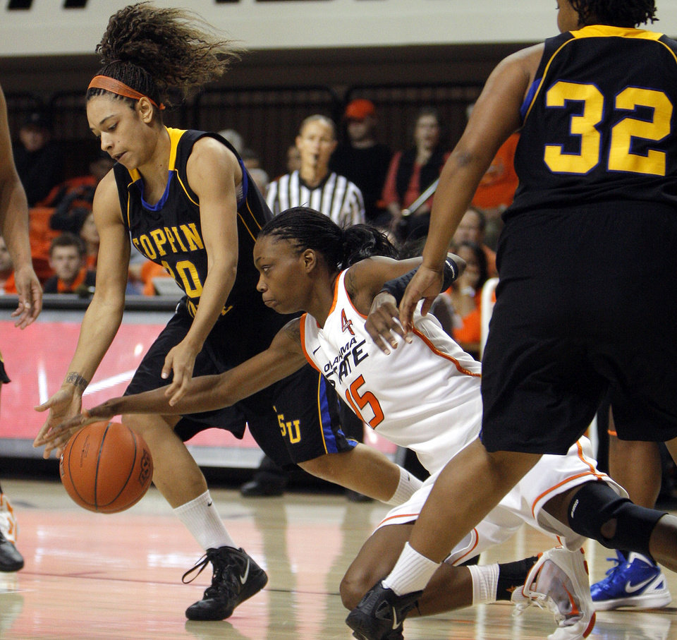 Photo - Oklahoma State's Toni Young (15) and Coppin State's Kyra Coleman (20) scramble for a loose ball during the women's college game between Oklahoma State University and Coppin State at Gallagher-Iba Arena in Stillwater, Okla.,  Saturday, Nov. 26, 2011.  Photo by Sarah Phipps, The Oklahoman