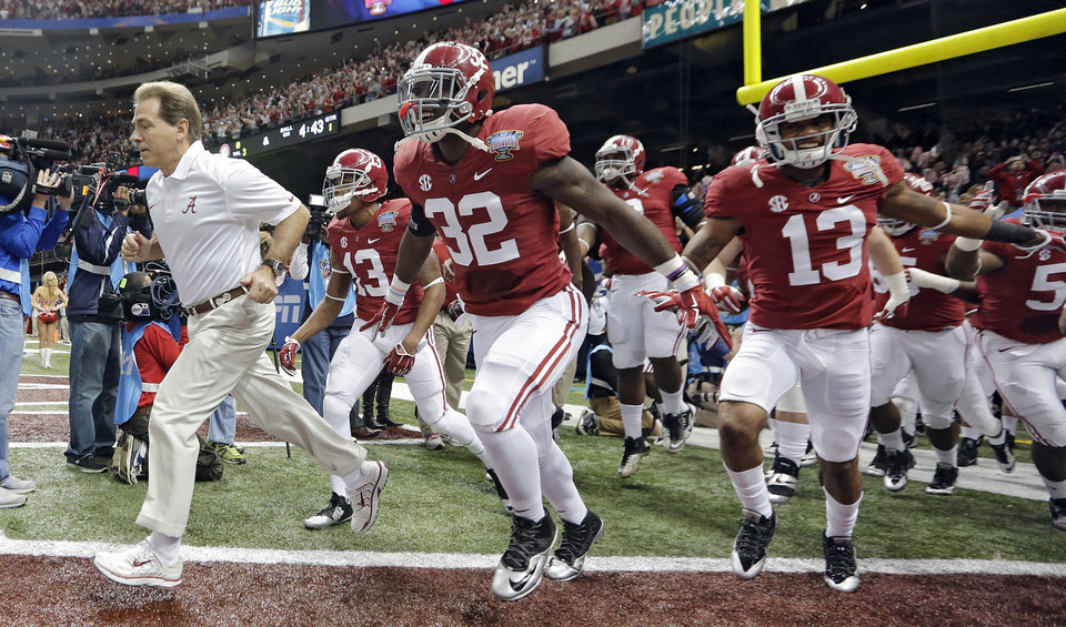 Alabama coach Nick Saban leads his team on the field during the NCAA football BCS Sugar Bowl game between the University of Oklahoma Sooners (OU) and the University of Alabama Crimson Tide (UA) at the Superdome in New Orleans, La., Thursday, Jan. 2, 2014.  .Photo by Chris Landsberger, The Oklahoman