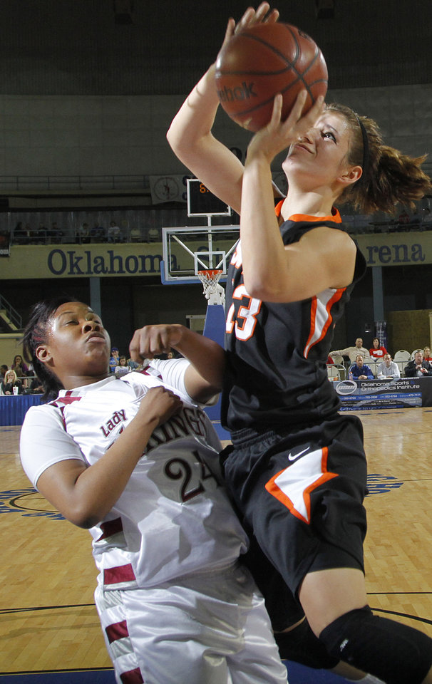 Photo - Snyder's Jordynn Vanpelt (13) shoots over Northeast's Jaelyn Coleman (24) during the semi final 2A girls State Basketball Championship game between Snyder High School and Northeast High School at the State Fair Arena on Friday, March 9, 2012 in Oklahoma City, Okla.  Photo by Chris Landsberger, The Oklahoman