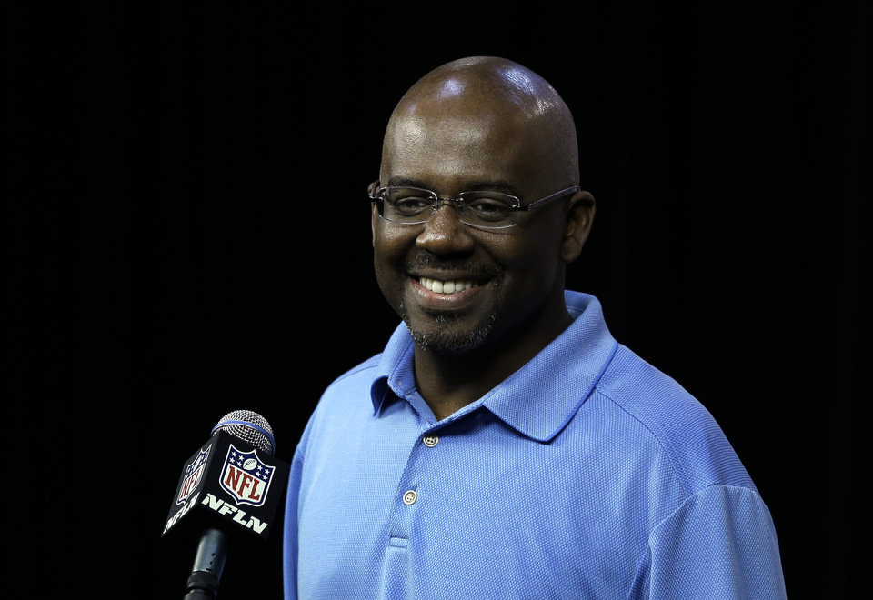 Photo - Detroit Lions general manager Martin Mayhew smiles about a question about the upcoming NFL football draft during a news conference in Allen Park, Mich., Thursday April 18, 2013. (AP Photo/Paul Sancya)