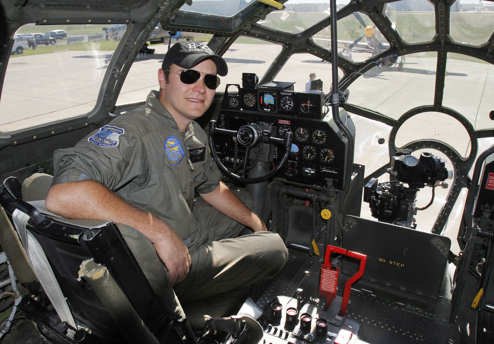 Photo - Pilot David Oliver sits in the cockpit of the last airworthy B-29 Superfortress after it flies into Wiley Post Airport in Oklahoma City, OK, Tuesday, October 2, 2012. It will be on exhibit for six days at Wiley Post Airport.  By Paul Hellstern, The Oklahoman