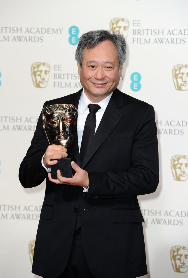 Photo - Director Ang Lee poses with the award for Cinematography in 2013 collected on behalf of Claudio Miranda backstage at the BAFTA Film Awards at the Royal Opera House on Sunday, Feb. 10, 2013, in London. (Photo by Jonathan Short/Invision/AP)