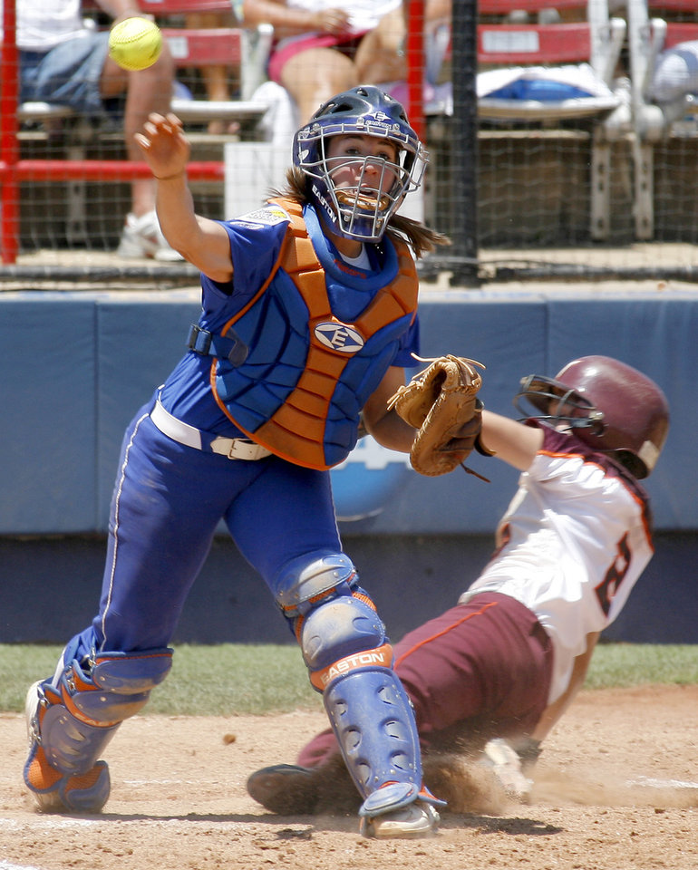 Photo - Florida's Kristina Hilberth throws for a double play after forcing out Virginia Tech's Jessica Everhart in the seventh inning  in the Women's College World Series between Florida and Virginia Tech at ASA Hall of Fame Stadium in Oklahoma City, Saturday, May 31, 2008. BY BRYAN TERRY, THE OKLAHOMAN