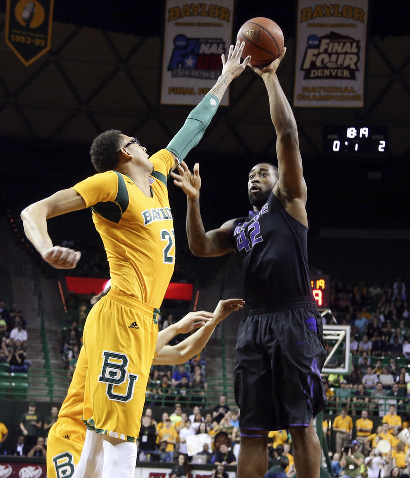 Photo - Kansas State forward Thomas Gipson (42) shoots over Baylor center Isaiah Austin, left, in the first half of an NCAA college basketball game Saturday, Feb. 15, 2014, in Waco, Texas. (AP Photo/The Waco Tribune-Herald, Rod Aydelotte)