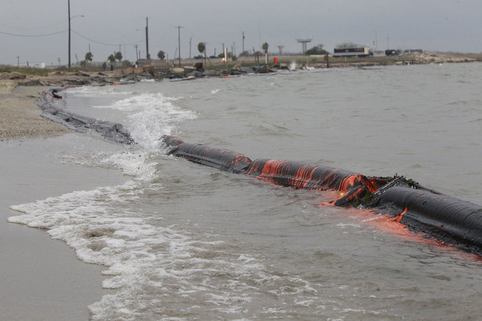 Photo - An oil containment boom is shown washed to shore on the beach area along Boddeker Rd. on the Eastern end of Galveston near the ship channel Sunday, March 23, 2014, in Galveston. (AP Photo/Houston Chronicle, Melissa Phillip)