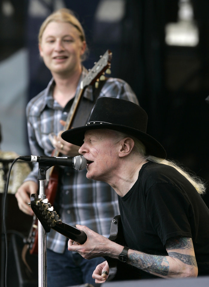 Photo - FILE - In this Saturday, July 28, 2007 file photo, Johnny Winter, seated, and Derek Trucks, background, perform