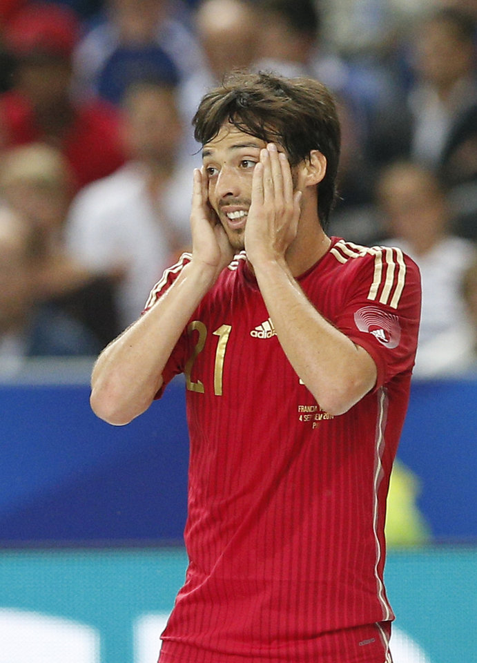 Photo - Spain's David Silva reacts after missing a goal against France during their international friendly soccer match at the Stade de France in Saint Denis, outside Paris, Thursday Sept. 4, 2014. (AP Photo/Christophe Ena)