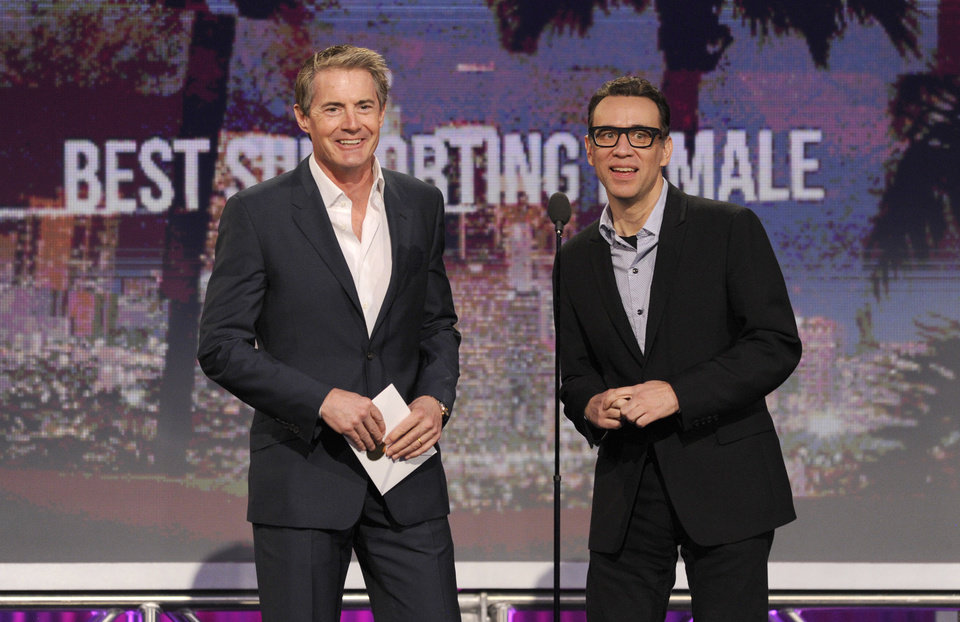 Actors Kyle MacLachlan, left, and Fred Armisen present the award for best supporting female at the Independent Spirit Awards on Saturday, Feb. 23, 2013, in Santa Monica, Calif. (Photo by Chris Pizzello/Invision/AP)