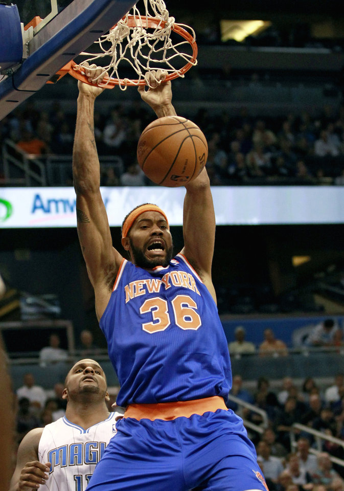 Photo -   New York Knicks' Rasheed Wallace (36) dunks the ball in front of Orlando Magic's Glen Davis, left, during the first half of an NBA basketball game, Tuesday, Nov. 13, 2012, in Orlando, Fla. (AP Photo/John Raoux)