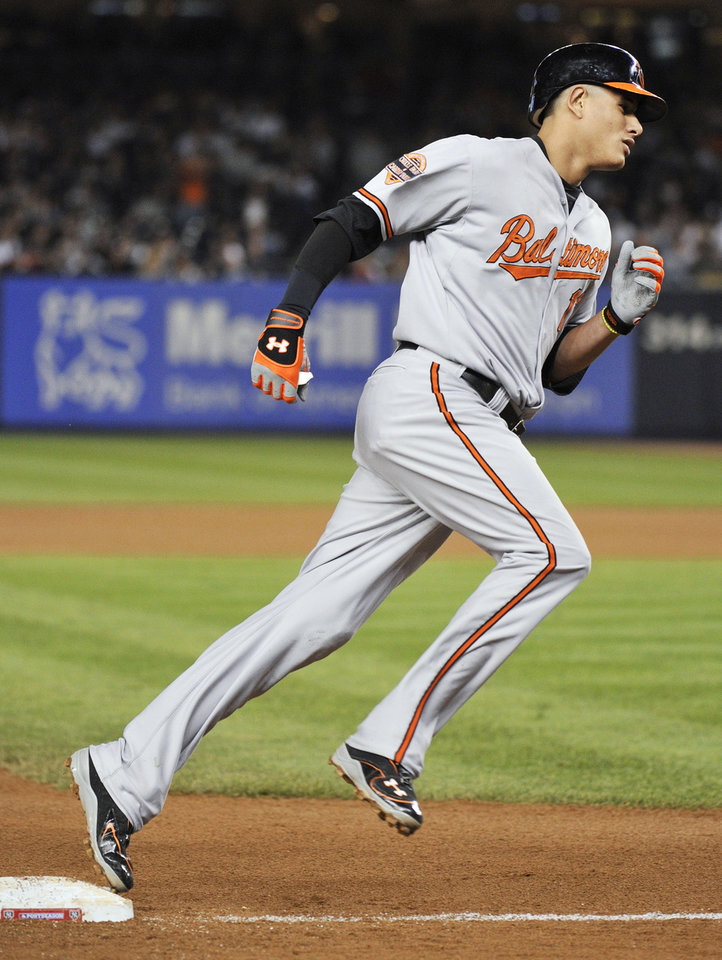 Baltimore Orioles' Manny Machado runs the bases after hitting a home run during the fifth inning against the New York Yankees in Game 3 of the American League division baseball series, Wednesday, Oct. 10, 2012, in New York. (AP Photo/Bill Kostroun)