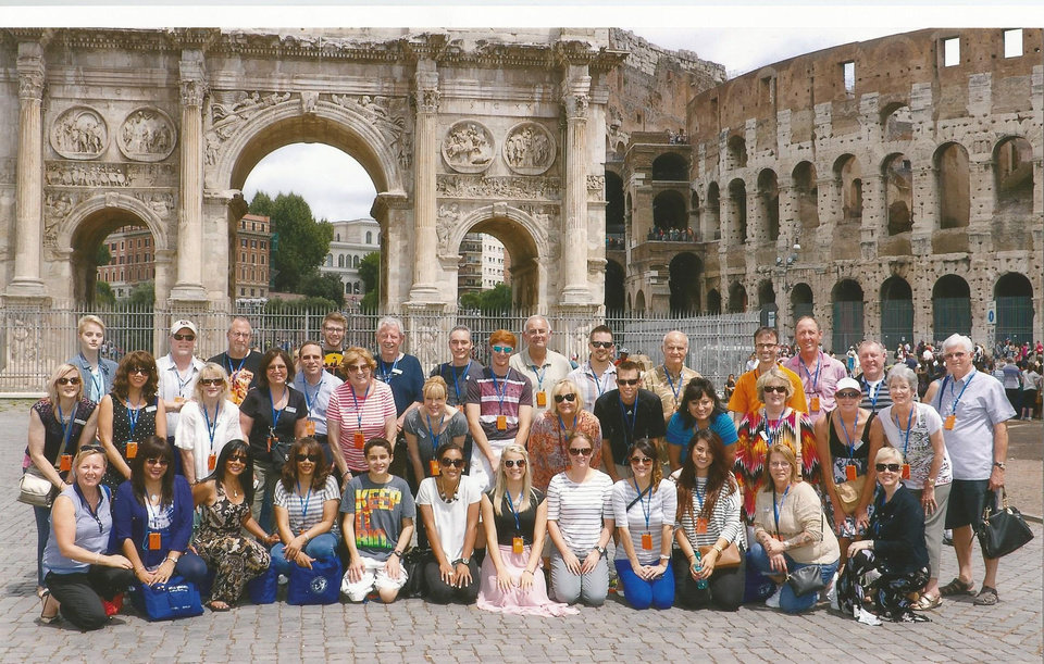 Photo -  An Insight Vacations tour group poses outside the Coliseum in Rome.