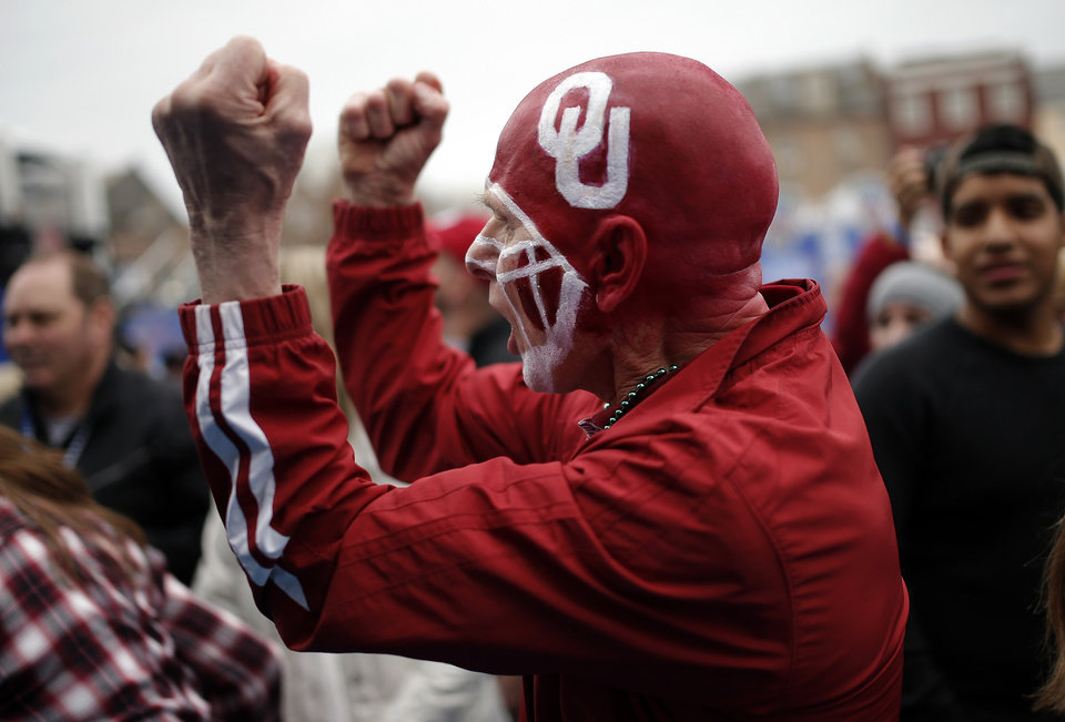 Photo - Mike Gillett of Geary, Okla., cheers at the Oklahoma pep rally in the French Quarter, Wednesday, Jan. 1, 2014 in New Orleans. Photo by Sarah Phipps, The Oklahoman