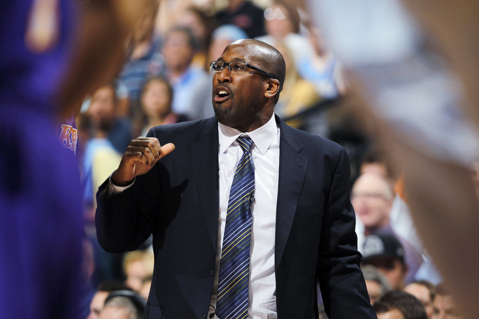 Los Angeles Lakers coach Mike Brown directs his team against the Denver Nuggets in the first quarter of Game 6 of a first-round NBA basketball playoff series in Denver on Thursday, May 10, 2012. (AP Photo/David Zalubowski) ORG XMIT: CODZ110