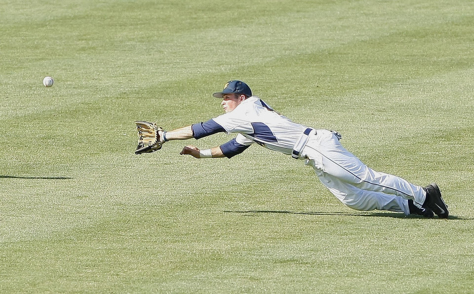 Photo - West Virginia center fielder Bobby Boyd leaps and catches a flyball to center field in the sixth inning of a second-round game against TCU in the Big 12 conference NCAA college baseball tournament in Oklahoma City, Thursday, May 22, 2014. (AP Photo/Alonzo Adams)