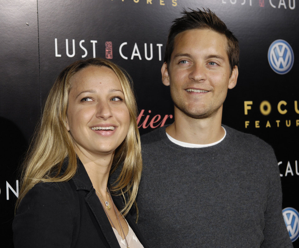 Photo - Actor Tobey Maguire and his wife Jennifer Meyer arrive at a screening of the film