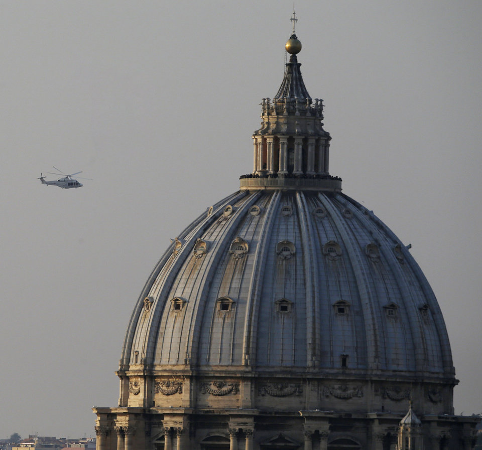 Photo - The helicopter taking Pope Benedict XVI to Castel Gandolfo leaves the Vatican in Rome, Thursday, Feb. 28, 2013. Shortly before 5 p.m. on Thursday, Pope Benedict left the Apostolic palace inside the Vatican for the last time as pontiff, headed to the helipad at the top of the hill in the Vatican gardens and flew to the papal retreat at Castel Gandolfo south of Rome. There, at 8 p.m. sharp, Benedict will become the first pontiff in 600 years to resign. (AP Photo/Gregorio Borgia)