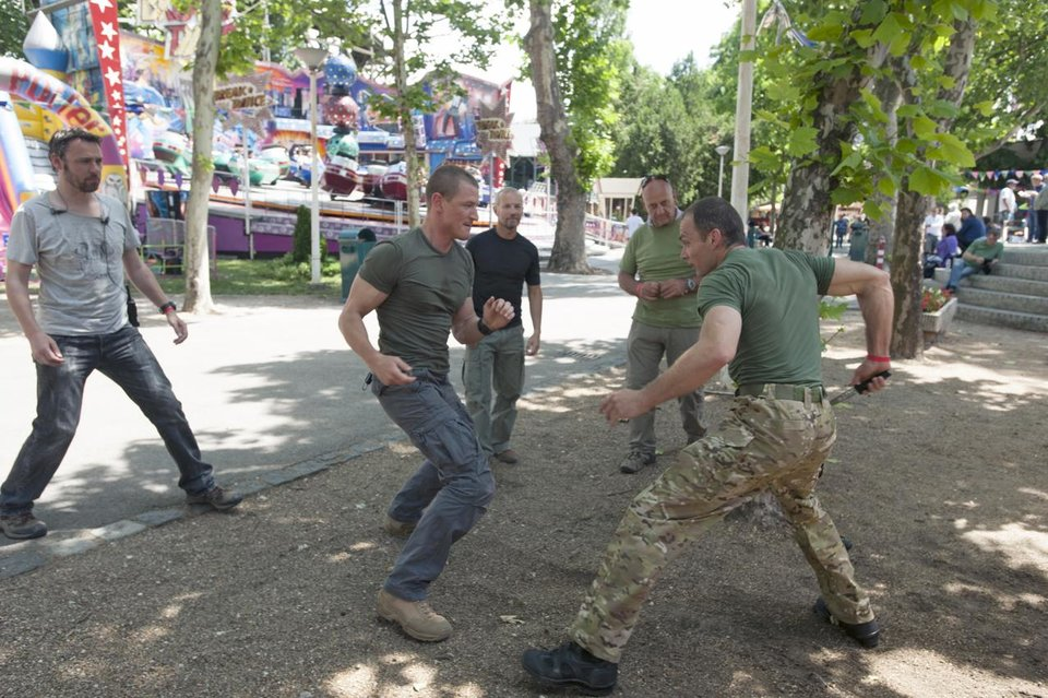 Photo -  Actor Philip Winchester (second from left) rehearses a fight scene on set with (from left to right) writer, director and co-executive producer Michael J. Bassett, military and stunt advisor Paul Hornsby, stunt coordinator Gareth Milne and stuntman Tibor Tamacsu. - Photo by Liam Daniel/Cinemax