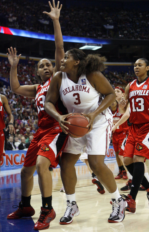 Photo - Courtney Paris shoots guarded by Monique Reid in the second half as the University of Oklahoma plays Louisville at the 2009 NCAA women's basketball tournament Final Four in the Scottrade Center in Saint Louis, Missouri on Sunday, April 5, 2009. Photo by Steve Sisney, The Oklahoman