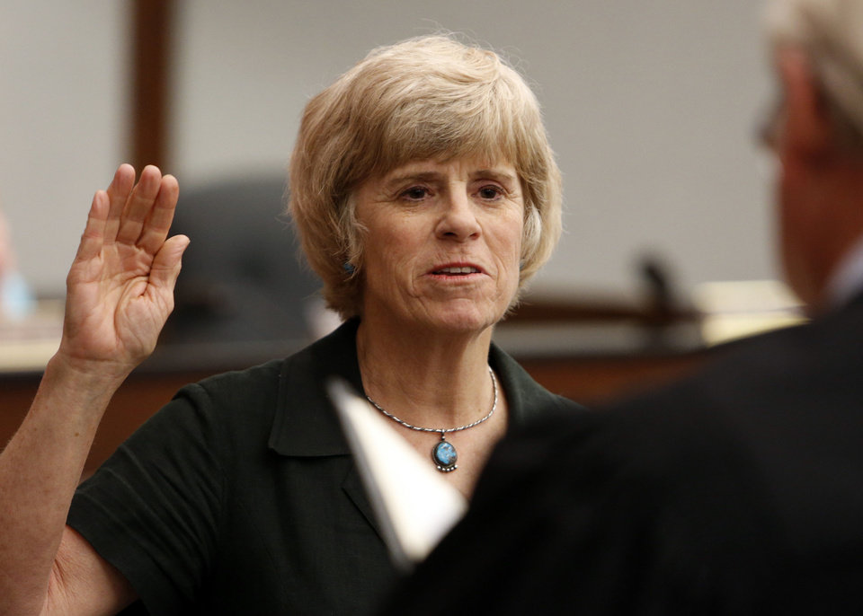 Photo - Norman Mayor Cindy Rosenthal takes the oath of office for a third three-year term. PHOTO BY STEVE SISNEY, THE OKLAHOMAN  STEVE SISNEY - THE OKLAHOMAN
