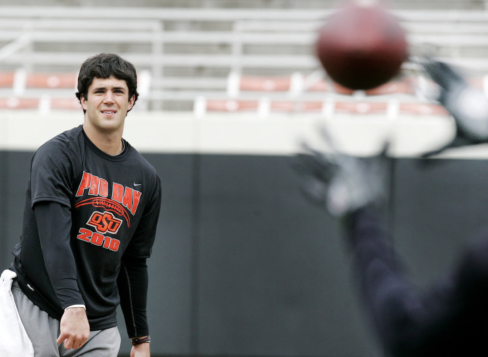 Photo - Former Oklahoma State quarterback Zac Robinson throws a pass during Pro Day at Boone Pickens Stadium in Stillwater on Wednesday.  Photo by Steve Gooch, The Oklahoman