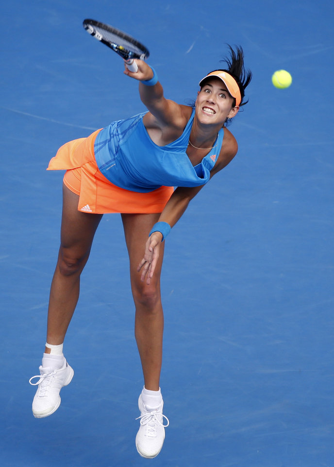 Photo - Garbine Muguruza of Spain serves to Caroline Wozniacki of Denmark during their third round match at the Australian Open tennis championship in Melbourne, Australia, Saturday, Jan. 18, 2014.(AP Photo/Eugene Hoshiko)