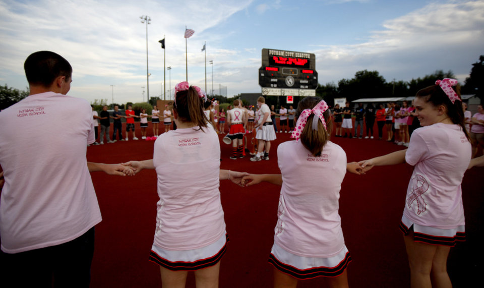 Photo - Wearing pink in support of Win-Win Week, Putnam City students cheer before the start of a high school football game between Putnam City and Choctaw in Oklahoma CIty, Thursday, September 16,  2010.  Photo by Bryan Terry, The Oklahoman