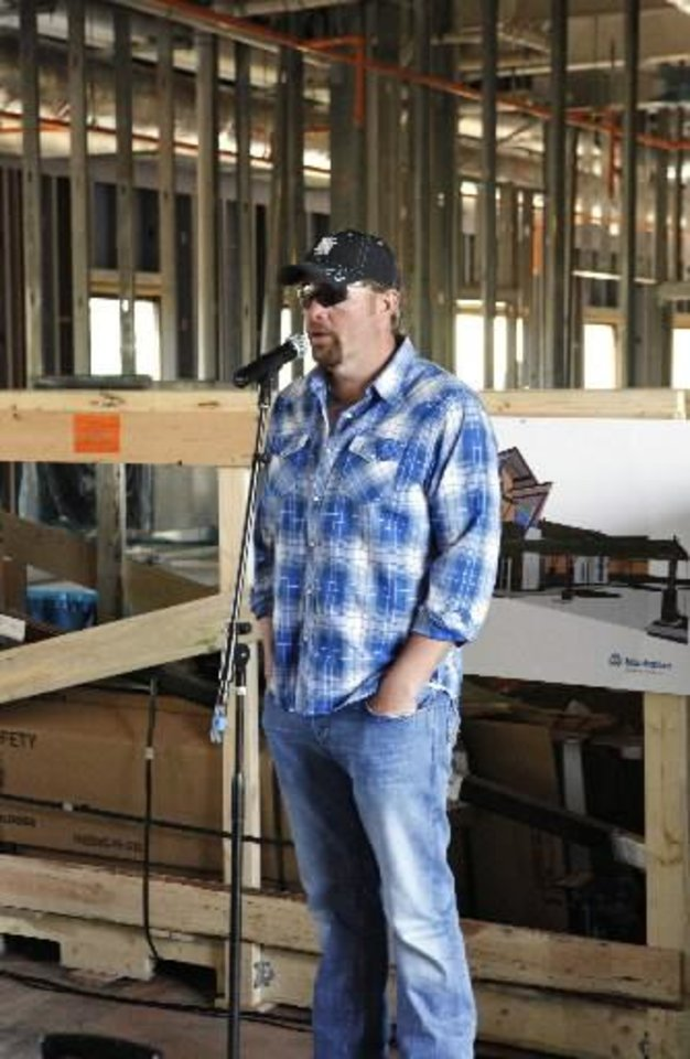 Toby Keith speaks to construction workers at the OK Kids Korral, 818 NE 8 Street, under construction in Oklahoma City Monday, April 1, 2013. Photo by Paul B. Southerland, The Oklahoman