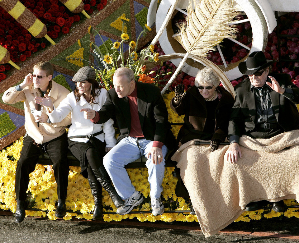 "Photo - Bart Conner, Nadia Comaneci, Barry Switzer, Patti Page and James Garner (from left to right) wave to the crowd from aboard the ""Our Good Nature"" float during the Tournament of Roses Parade in Pasadena, Ca., on Monday, Jan. 1, 2007. By John Clanton, The Oklahoman"