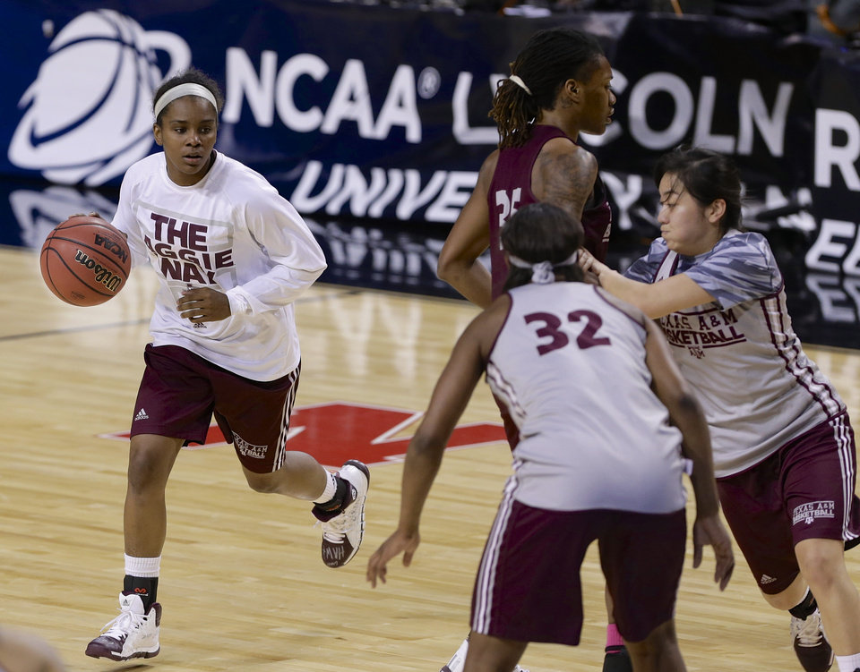 Photo - Texas A&M's Jordan Jones, left, participates in NCAA college basketball practice in Lincoln, Neb., Friday, March 28, 2014. Texas A&M will play DePaul in an NCAA Lincoln Regional women's semifinal basketball game on Saturday. (AP Photo/Nati Harnik)