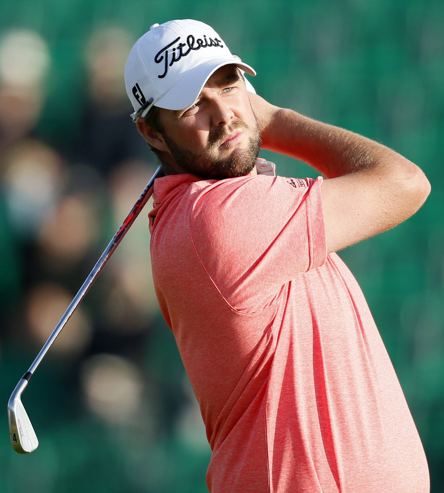 Photo - Marc Leishman of Australia watches his shot off the 4th tee during the first day of the British Open Golf championship at the Royal Liverpool golf club, Hoylake, England, Thursday July 17, 2014. (AP Photo/Alastair Grant)