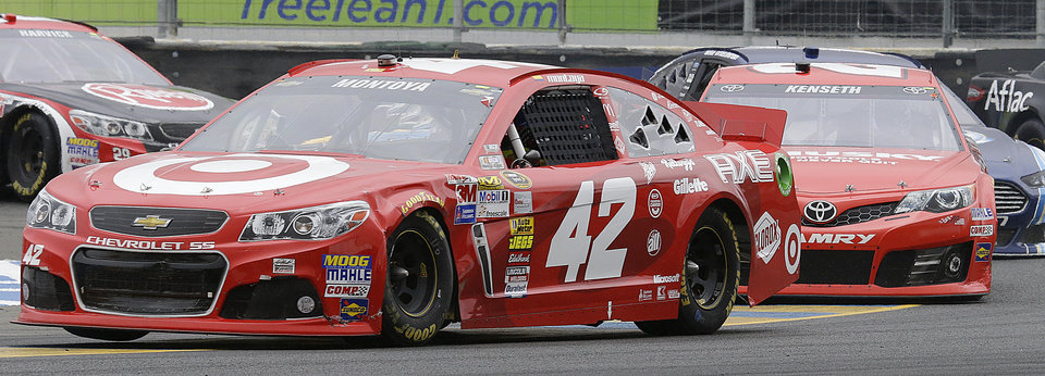 Juan Pablo Montoya (42), of Colombia, races during the NASCAR Sprint Cup Series auto race on Sunday, June 23, 2013, in Sonoma, Calif. (AP Photo/Ben Margot)