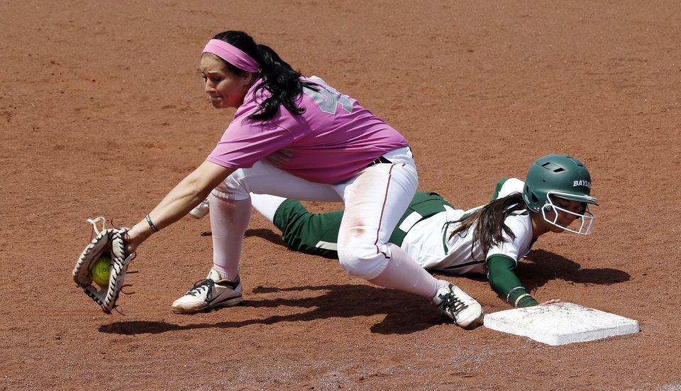 Sooner first baseman Lauren Chamberlain tries to put out runner Justine Young as the University of Oklahoma (OU) Sooners play the Baylor Bears in NCAA college softball at Marita Hines Field on Saturday, April 6, 2013  in Norman, Okla. Photo by Steve Sisney, The Oklahoman