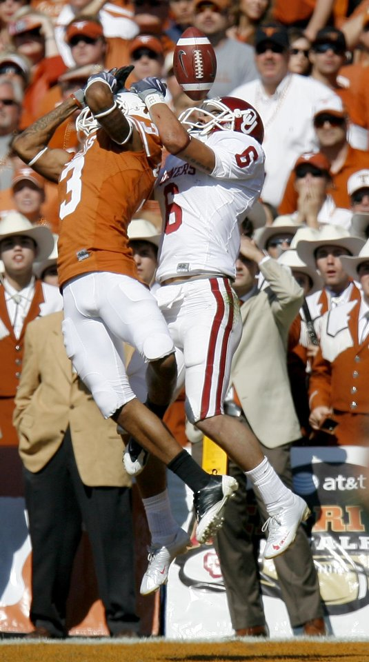 Photo - Curtis Brown of Texas breaks up a pass intended for OU's Cameron Kenney during the Red River Rivalry college football game between the University of Oklahoma Sooners (OU) and the University of Texas Longhorns (UT) at the Cotton Bowl in Dallas, Texas, Saturday, Oct. 17, 2009. Photo by Bryan Terry, The Oklahoman