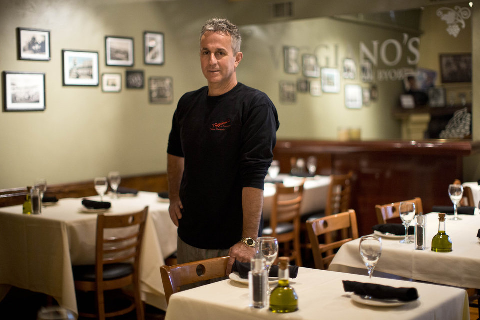 Photo - In this Thursday, May 29, 2014 photo, Mark Viggiano, owner of Viggiano's Italian BYOB, poses for a portrait, in Conshohocken, Pa. Viggiano lost his restaurant during the recession and reopened it about a year ago. (AP Photo/Matt Rourke)
