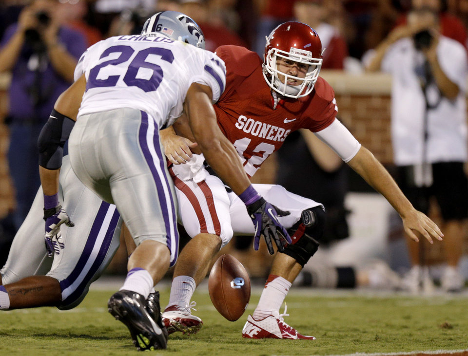Oklahoma's Landry Jones (12) fumbles the ball as Kansas State's Jarell Childs (26) recovers the ball for a touchdown during a college football game between the University of Oklahoma Sooners (OU) and the Kansas State University Wildcats (KSU) at Gaylord Family-Oklahoma Memorial Stadium, Saturday, September 22, 2012. Photo by Bryan Terry, The Oklahoman