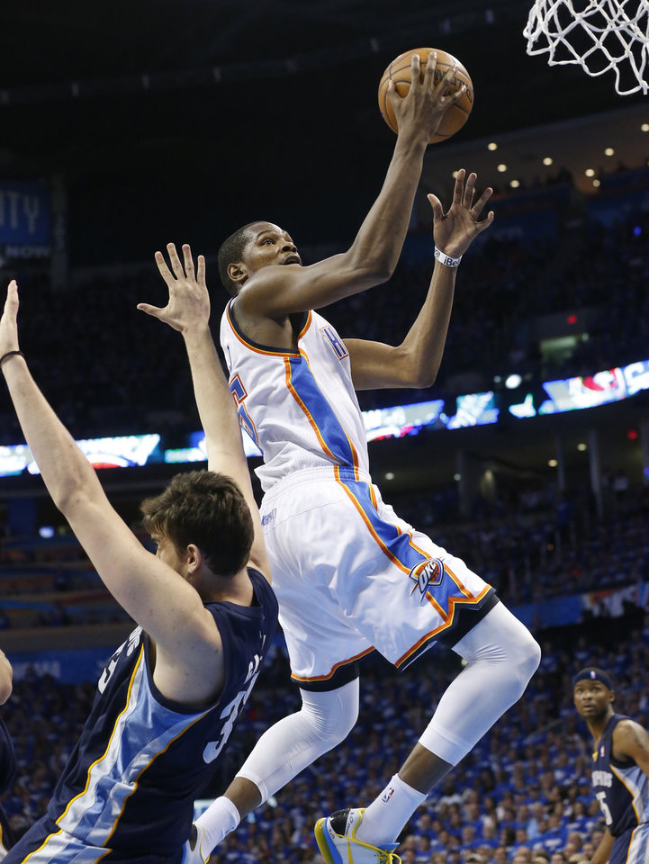 Photo - Oklahoma City Thunder forward Kevin Durant (35) shoots in front of Memphis Grizzlies center Marc Gasol (33) during the fourth quarter of Game 1 of their NBA basketball playoff series in the Western Conference semifinals, Sunday, May 5, 2013, in Oklahoma City. Oklahoma City won 93-91. (AP Photo/Sue Ogrocki)