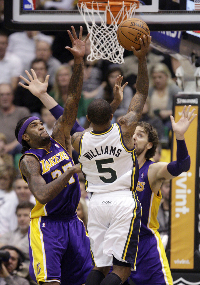 Utah Jazz guard Mo Williams (5) shoots as Los Angeles Lakers center Jordan Hill, left, and forward Pau Gasol defend during the second quarter of an NBA basketball game Wednesday, Nov. 7, 2012, in Salt Lake City. (AP Photo/Rick Bowmer)