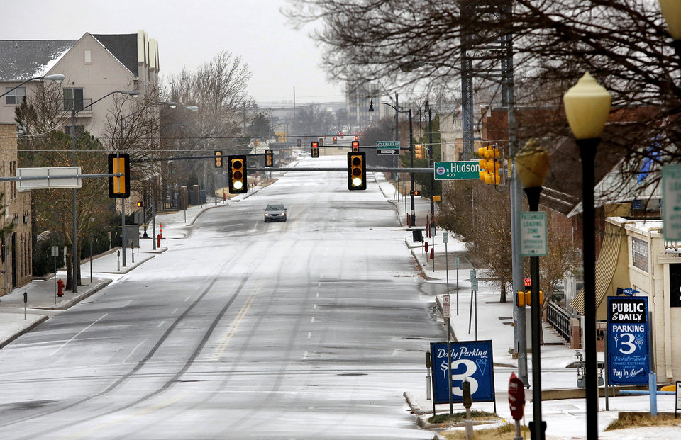 Photo - A white Christmas in downtown Oklahoma City, Dec. 25, 2012. Looking west down NW 4th from Harvey.   Photo by Jim Beckel, The Oklahoman
