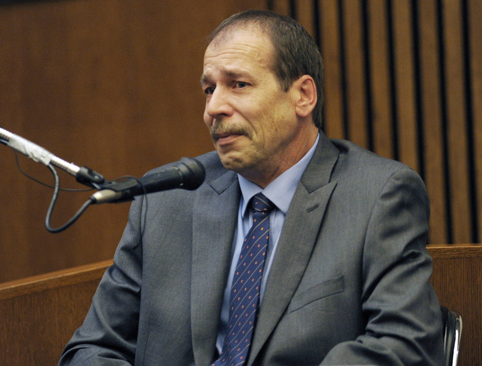 Photo - FILE - In this Aug. 4, 2014 file photo, Theodore Wafer, of Dearborn Heights, Mich., testifies in his own defense during his trial for the Nov. 2, 2013, killing of Renisha McBride in Detroit. Wafer is scheduled to return to court for sentencing next Wednesday,  Sept. 3, 2014, about a month after he was convicted of second-degree murder in the shooting of Renisha McBride. Prosecutors want the judge to follow sentencing guidelines and send Wafer to prison for at least 17 years for murder and the unlawful use of a gun. Defense attorney Cheryl Carpenter is asking for as little as six years. (AP Photo/Detroit News, Clarence Tabb Jr., File)