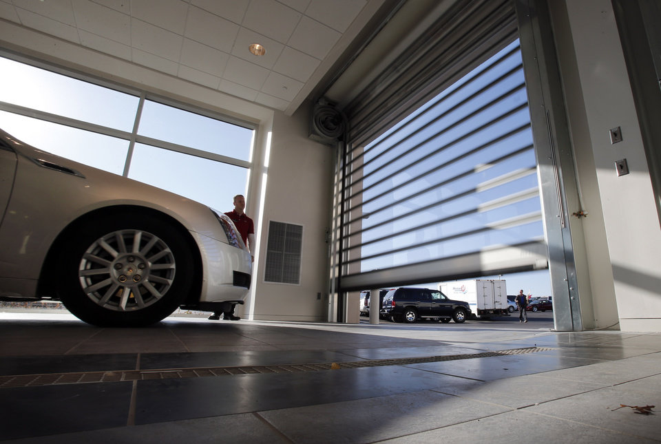 High speed service garage doors are motion activated and take about a second to open at the Bob Moore Cadillac store on I-35 and Indian Hills Rd. on Wednesday, Nov. 28, 2012 in Norman, Okla.  Photo by Steve Sisney