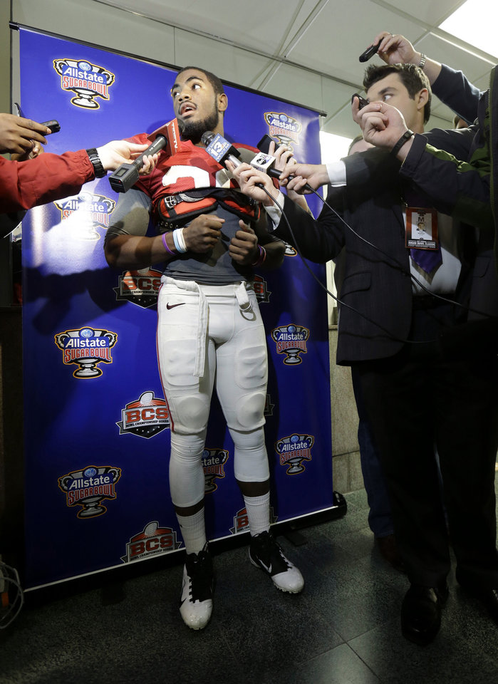 Photo - Alabama defensive back Landon Collins speaks to reporters after practice for an the Jan. 2 Sugar Bowl NCAA college football game against Oklahoma, in New Orleans on Saturday, Dec. 28, 2013. (AP Photo/Gerald Herbert)