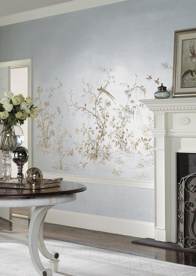 Silvered and sparkling, a wallpaper mural inspired by an antique Chinese embroidery brightens this entire room. Photo: Courtesy York. <strong></strong>
