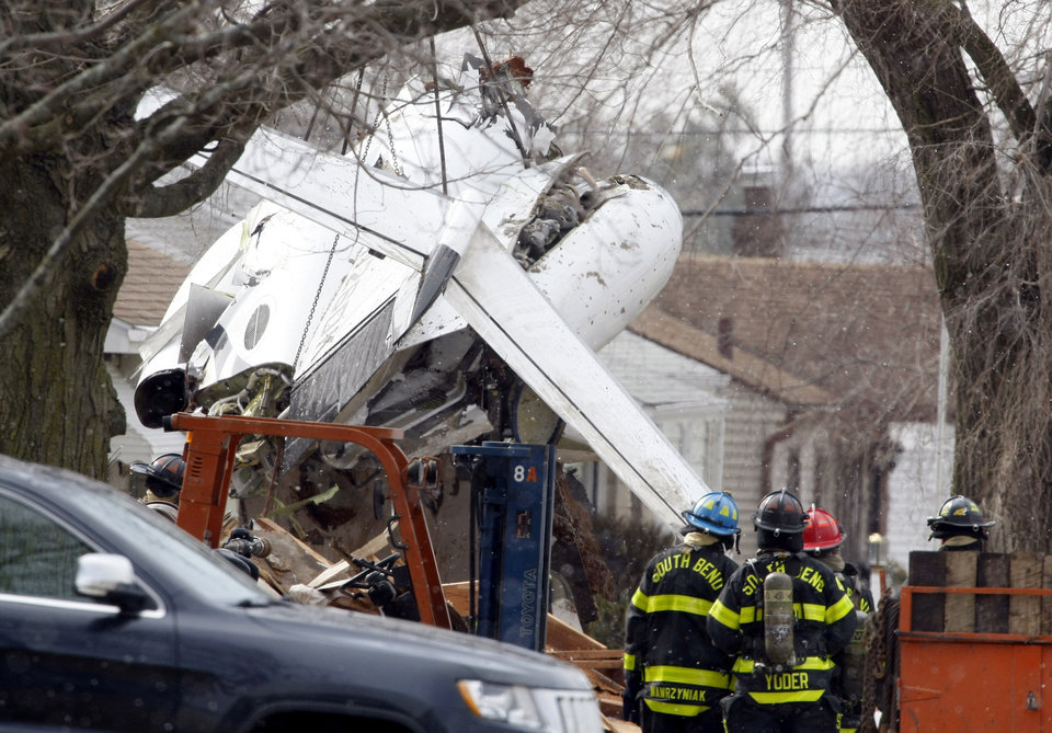 Wreckage is shown March 19, two days after a private jet crashed into a home near the South Bend Regional Airport in South Bend, Ind. Former University of Oklahoma quarterback Steve Davis died in the crash. AP PHOTO
