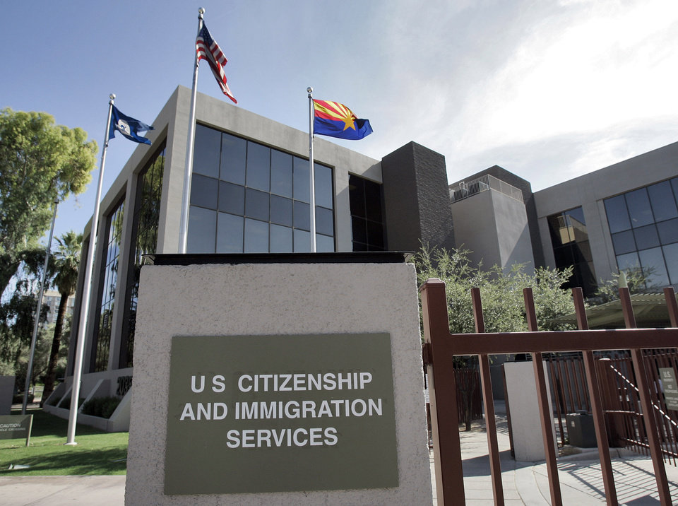 FILE � This Aug. 5, 2008, file photo, shows the U.S. Citizenship and Immigration Services building Phoenix. The U.S. Supreme Court will struggle this week with the validity of an Arizona law that tries to keep illegal immigrants from voting by demanding all state residents show documents proving their U.S. citizenship before registering to vote in national elections. (AP Photo/Matt York, File)