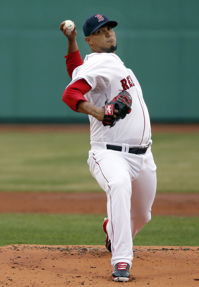 Photo - Boston Red Sox starting pitcher Felix Doubront delivers to the Texas Rangers in the first inning of a baseball game at Fenway Park in Boston, Tuesday, April 8, 2014. (AP Photo/Elise Amendola)