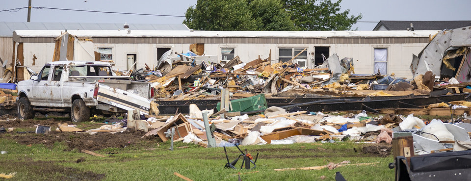 Photo - Storm damage and debris left behind at the Skyview Mobile Home Park in the aftermath of a tornado in El Reno, Okla. on Monday, May 27, 2019. The EF3 tornado hit the area on Saturday night killing two people and injuring many others. [Chris Landsberger/The Oklahoman]