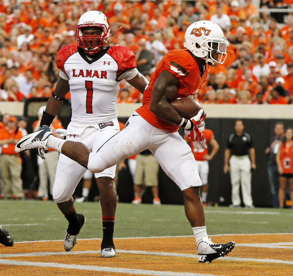 Photo - Oklahoma State's Jeremy Smith (31) rushes for a touchdown in front of Lamar's Nashon Davis (1) in the first quarter during a college football game between the Oklahoma State University Cowboys (OSU) and the Lamar University Cardinals at Boone Pickens Stadium in Stillwater, Okla., Saturday, Sept. 14, 2013. Photo by Nate Billings, The Oklahoman